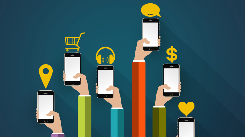 Concept for mobile apps - smartphones on hands with mobile applications